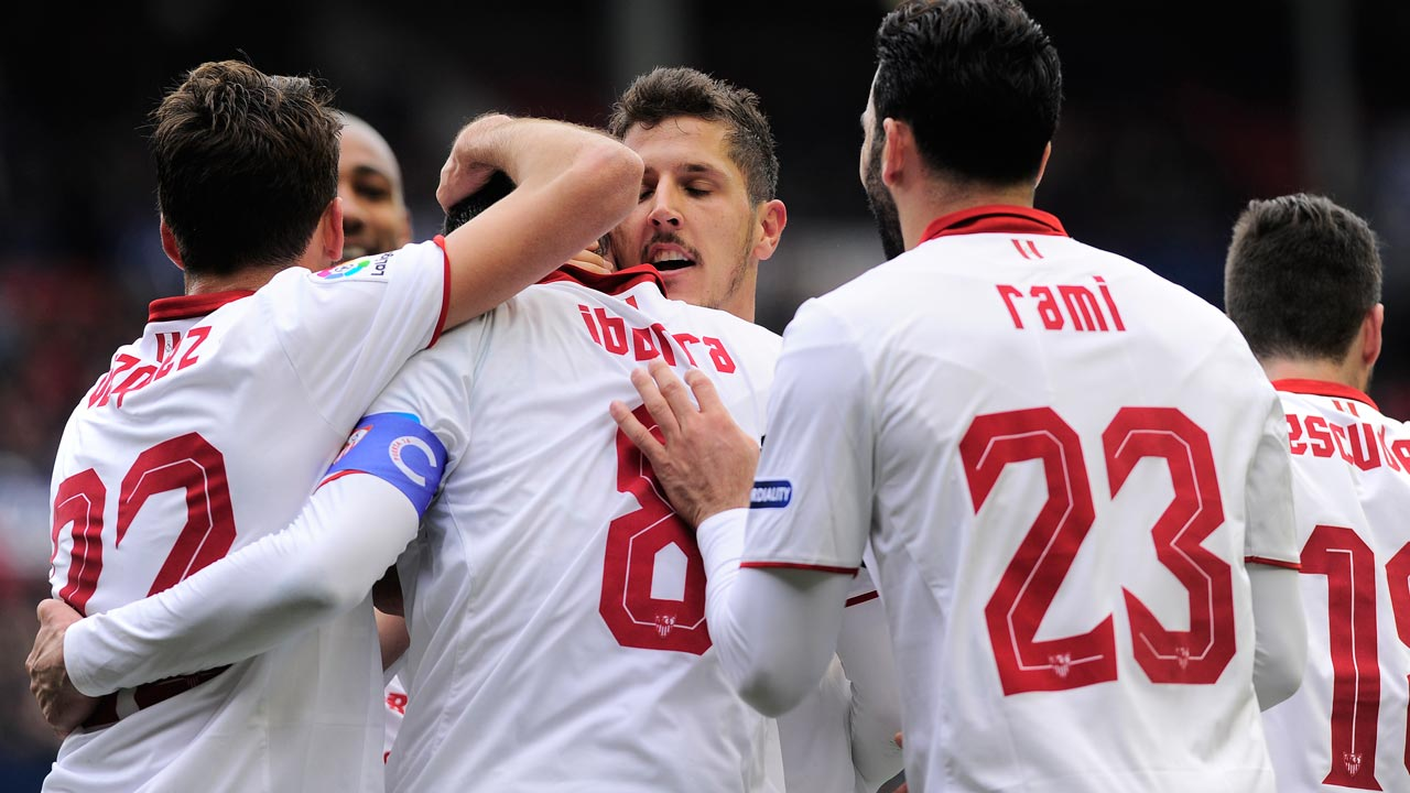 Sevilla's playres celebrate after midfielder Vicente Iborra scoring his team's first goal during the Spanish league football match CA Osasuna vs Sevilla FC at El Sadar stadium in Pamplona on January 22, 2017. ANDER GILLENEA / AFP