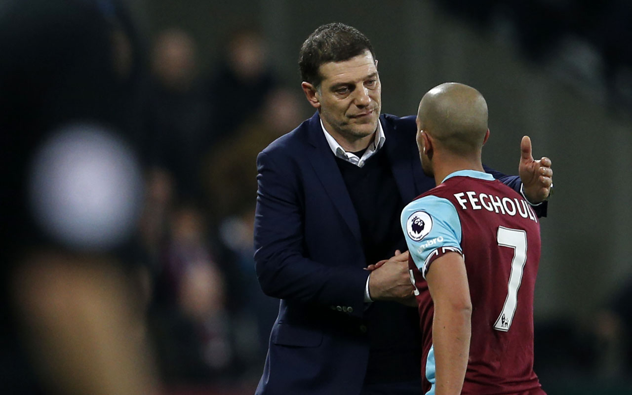 West Ham United's French-born Algerian midfielder Sofiane Feghouli (R) shakes hands with West Ham United's Croatian manager Slaven Bilic after being sent off for the tackle on Phil Jones during the English Premier League football match between West Ham United and Manchester United at The London Stadium, in east London on January 2, 2017. / AFP PHOTO / Adrian DENNIS /