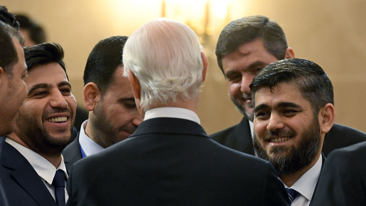 Chief opposition negotiator Mohammad Alloush (R) of the Jaish al-Islam (Army of Islam) rebel group listens to UN envoy for Syria Staffan de Mistura prior to the first session of Syria peace talks at Astana's Rixos President Hotel on January 23, 2017. Kirill KUDRYAVTSEV / AFP