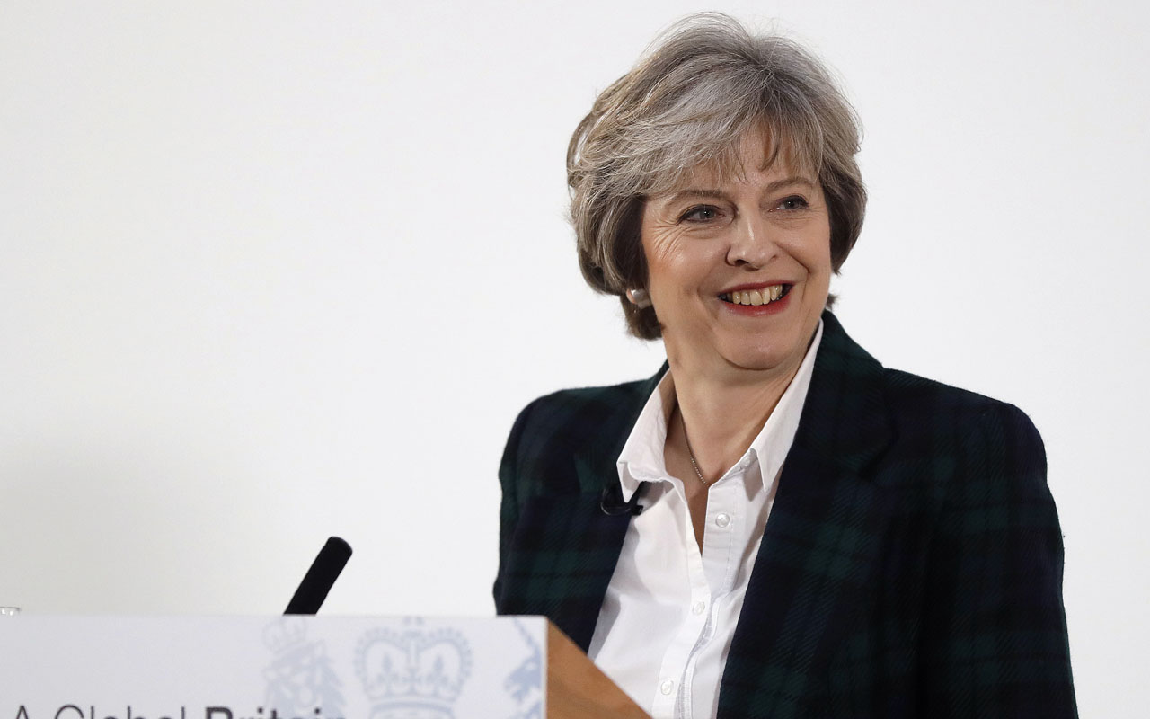 British Prime Minister Theresa May delivers a speech on the government's plans for Brexit at Lancaster House in London on January 17, 2017. Prime Minister Theresa May on Tuesday said Britain will leave the EU's single market in order to restrict immigration in a clean break from the bloc, but lawmakers can vote on the final deal. / AFP PHOTO / POOL / Kirsty Wigglesworth