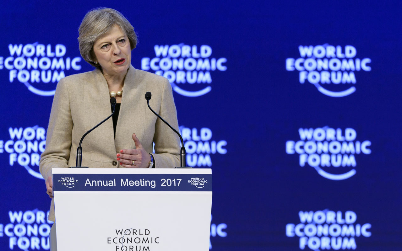 British Prime Minister Theresa May delivers her speech on the third day of the Forum's annual meeting, on January 19, 2017 in Davos. Theresa May addresses the World Economic Forum in Davos just two days after unveiling her blueprint for the country's departure from the European Union / AFP PHOTO / FABRICE COFFRINI