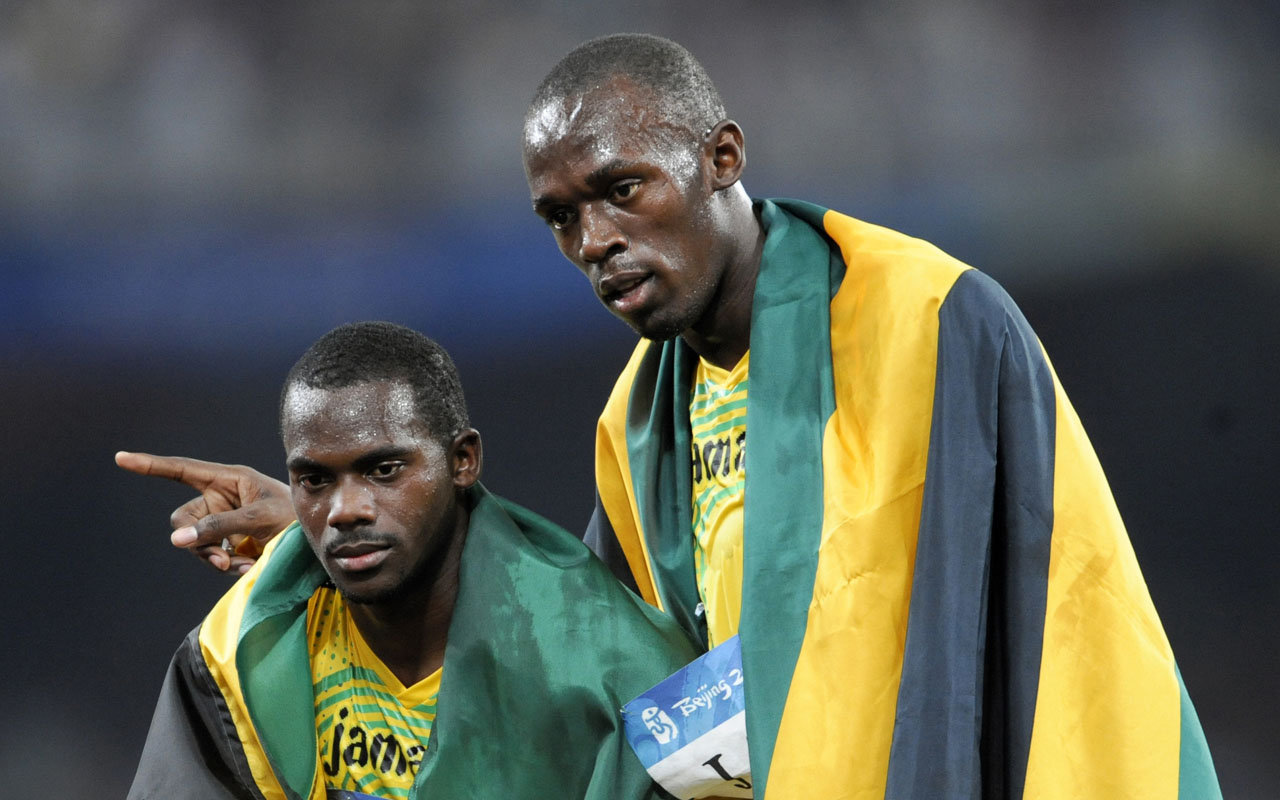"Jamaica's Nesta Carter (L) and Usain Bolt celebrating after winning the men's 4×100m relay final at the ""Bird's Nest"" National Stadium during the 2008 Beijing Olympic Games. The International Olympic Committee said on January 25, 2017 it had stripped Jamaica of their gold medal earned in the 4x100m relay at the 2008 Beijing Games after Nesta Carter was caught doping.The decision which follows the retesting of hundreds of samples from the Beijing event, means teammate Usain Bolt loses one of the three gold medals he won at that Olympics. Carter was found to have tested positive for banned substance Methylhexanamine.  / AFP PHOTO / Olivier MORIN"
