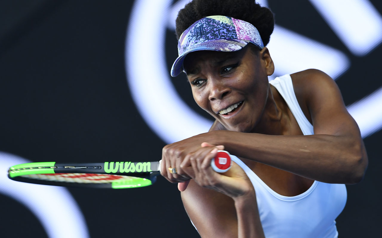 Venus Williams of the US hits a return against Duan Ying-Ying of China during their women's singles third round match on day five of the Australian Open tennis tournament in Melbourne on January 20, 2017. / AFP PHOTO / GREG WOOD /