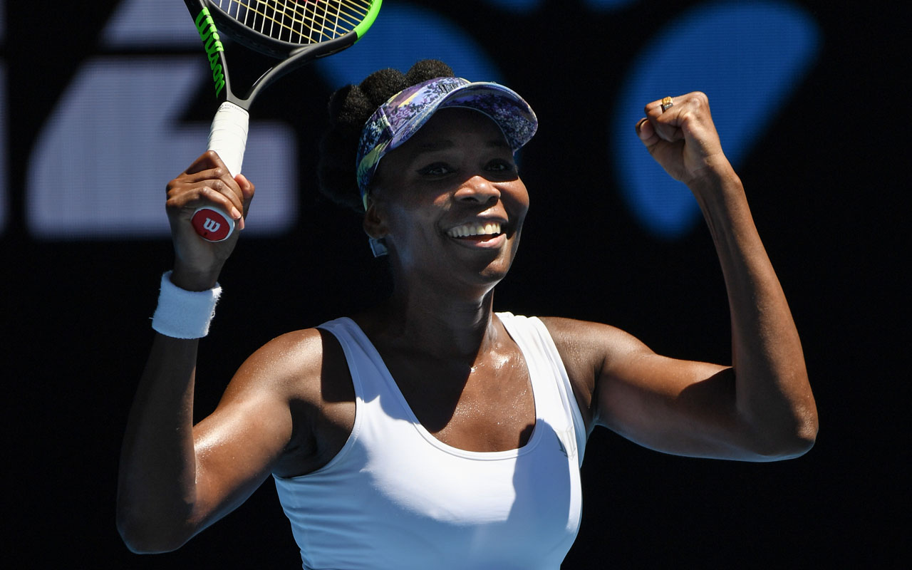 Venus Williams of the US celebrates her victory against Germany's Mona Barthel during their women's singles fourth round match on day seven of the Australian Open tennis tournament in Melbourne on January 22, 2017. / AFP PHOTO / GREG WOOD /