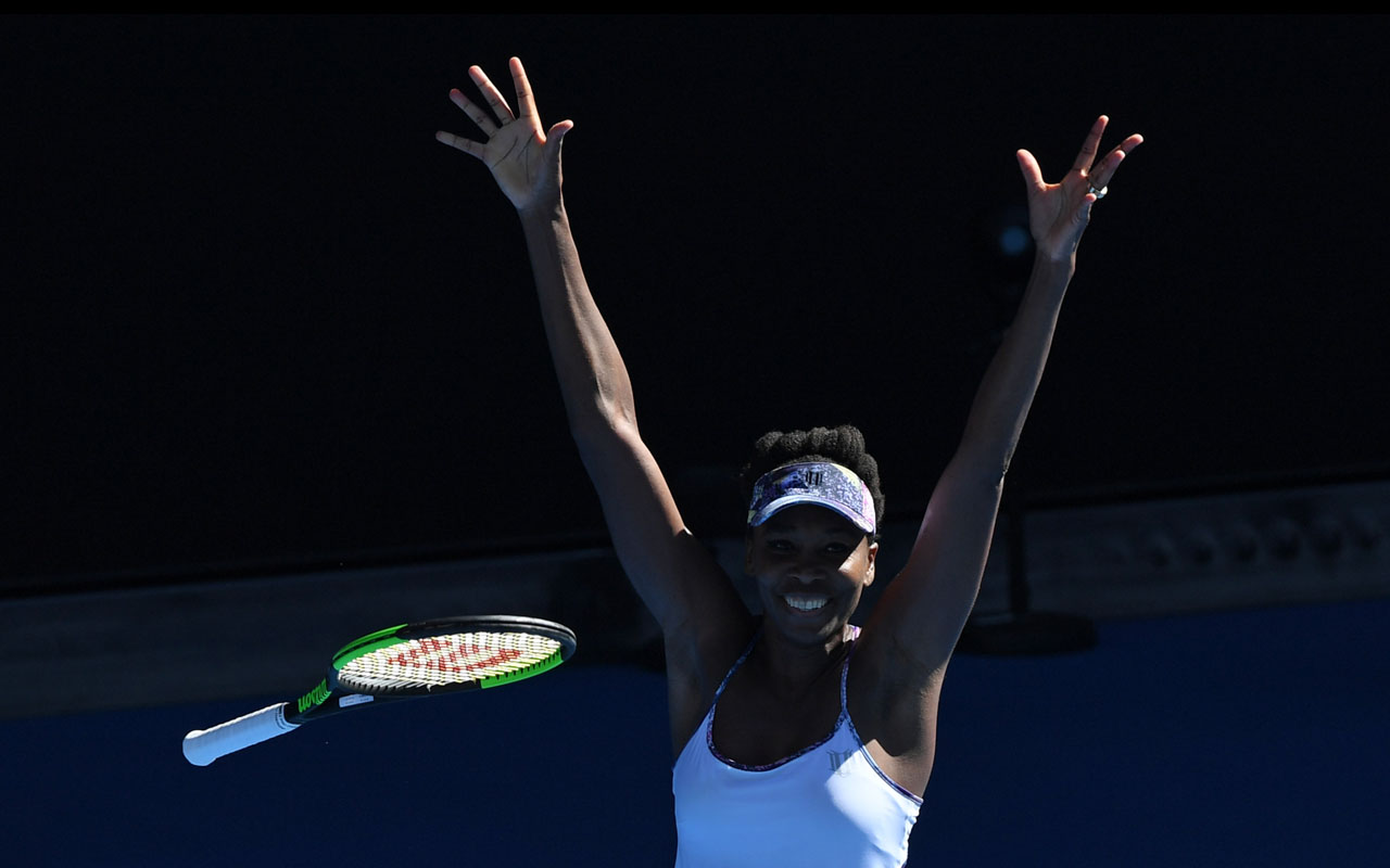 Venus Williams of the US celebrates her victory against Coco Vandeweghe of the US during their women's singles semi-final match on day 11 of the Australian Open tennis tournament in Melbourne on January 26, 2017. / AFP PHOTO / SAEED KHAN /
