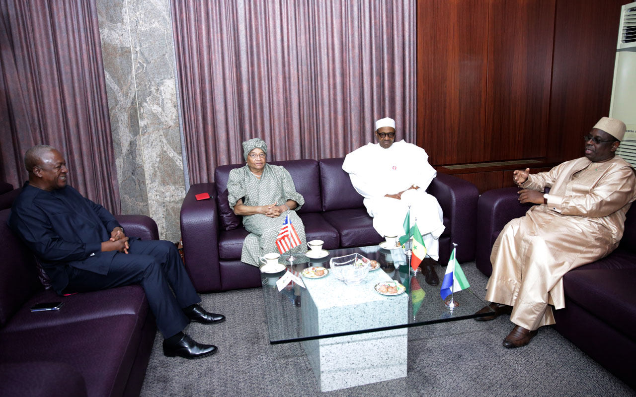 (From L) Former President of Ghana John Mahama, President of Liberia Ellen Johnson Sirleaf, President of Nigeria Muhammadu Buhari and President of Senegal Macky Sall meet in Abuja on January 9, 2017, on the political situation in Gambia. West African leaders announced on January 9 they would return to Gambia to persuade President Yahya Jammeh to step down, as the strongman was left looking increasingly isolated at home and abroad. / AFP PHOTO / SUNDAY AGHAEZE