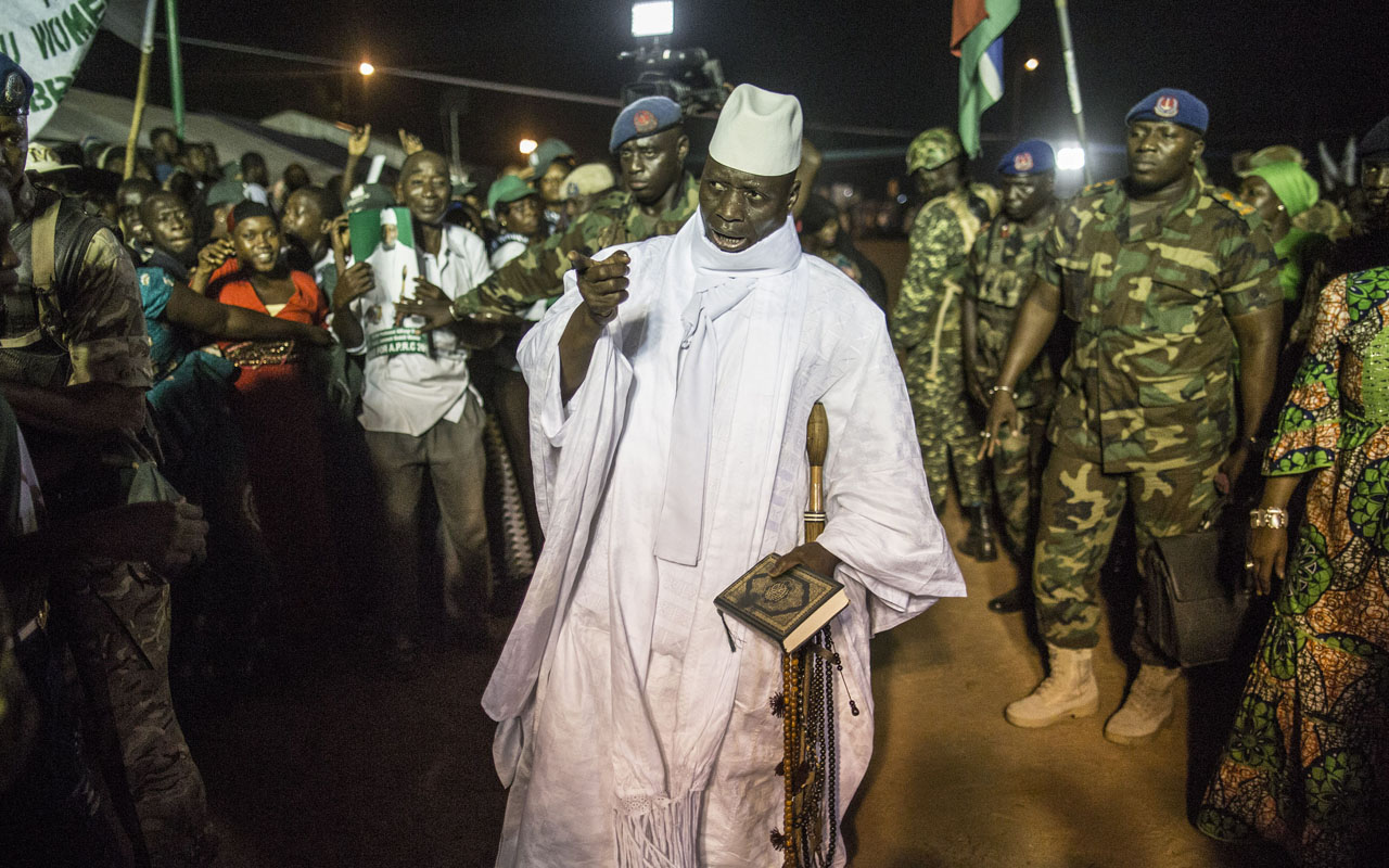 (FILES) This file photo taken on November 24, 2016 in Brikama shows Gambia's incumbent President Yahya Jammeh (C) greeted by supporters as he arrives at a campaign rally ahead of the December 1 presidential election. Gambian president declares state of emergency, AFP reported on January 17, 2017 as President Yahya Jammeh is refusing to quit days before the planned inauguration of his rival Adama Barrow. / AFP PHOTO / MARCO LONGARI