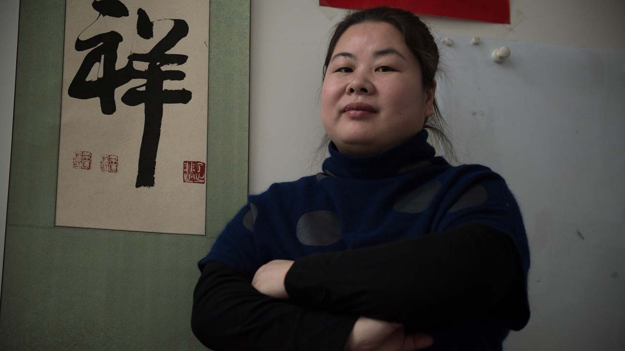 This picture taken on January 25, 2017 shows Chinese women's rights activists Ye Haiyan in Beijing. Haiyan, one of China's most prominent women's rights activists, huddled in her unheated apartment on the outskirts of Beijing, waiting to learn if the documentary that propelled her to international fame would receive an Oscar nod. STR / AFP