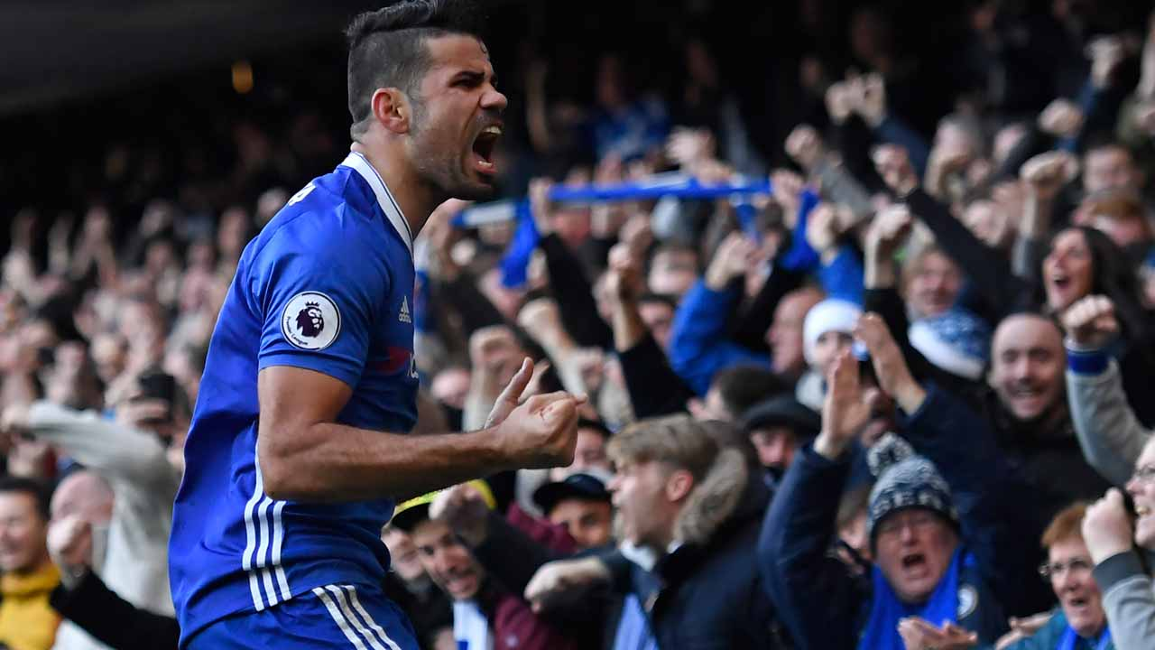 (FILES) This file photo taken on December 11, 2016 shows Chelsea's Brazilian-born Spanish striker Diego Costa celebrating after scoring the opening goal of the English Premier League football match between Chelsea and West Bromwich Albion at Stamford Bridge in London. The seeds for Chelsea's current run of wins were sown during a 3-0 defeat at Arsenal in late September, when new manager Antonio Conte switched to his preferred 3-4-3 formation. Justin TALLIS / AFP