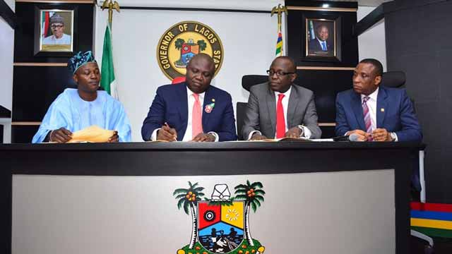 Lagos State Governor Akinwunmi Ambode (second left), Chairman, House Committee on Appropriation, Rotimi Olowo (left), Commissioner for Finance, Economic Planning & Budget, Mr. Akinyemi Ashade (second right) and Secretary to the State Government, Mr. Tunji Bello (right) at the signing into law of the 2017 Appropriation Bill at the Lagos House, Ikeja…yesterday