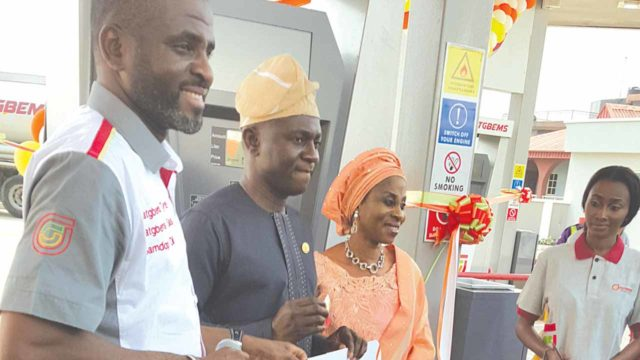 Chairman, Fatgbems Petroleum, Kabir Gbemisola (left); Lagos State Commissioner for Energy and Mineral Resources, Wale Oluwo and Gbemisola's wife, Ramota, at the unveiling of the fuel station… in Lagos