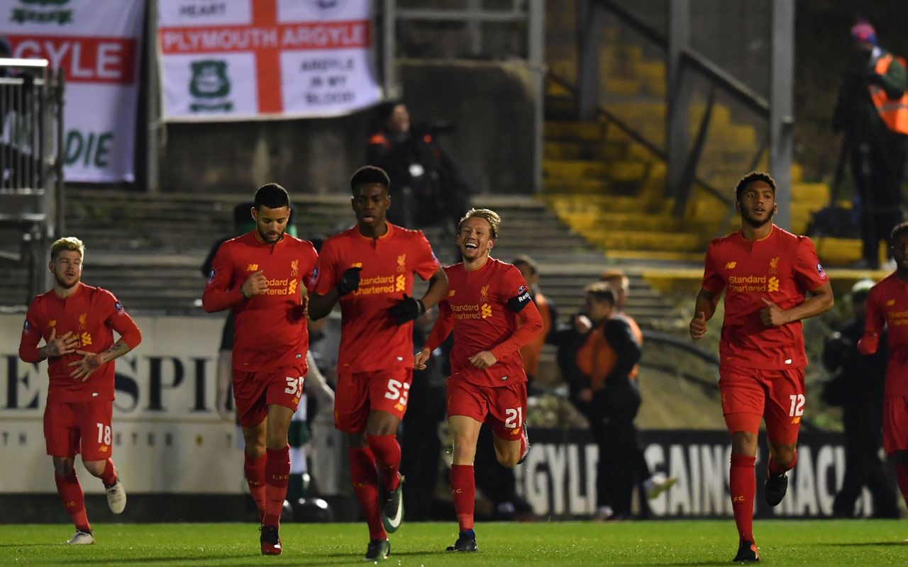 Liverpool's Brazilian midfielder Lucas Leiva (C) runs back to the half way line with teammates after scoring the opening goal of the English FA Cup third round replay football match between Plymouth Argyle and Liverpool at Home Park in Plymouth, south west England on January 18, 2017. / AFP PHOTO / Ben STANSALL /
