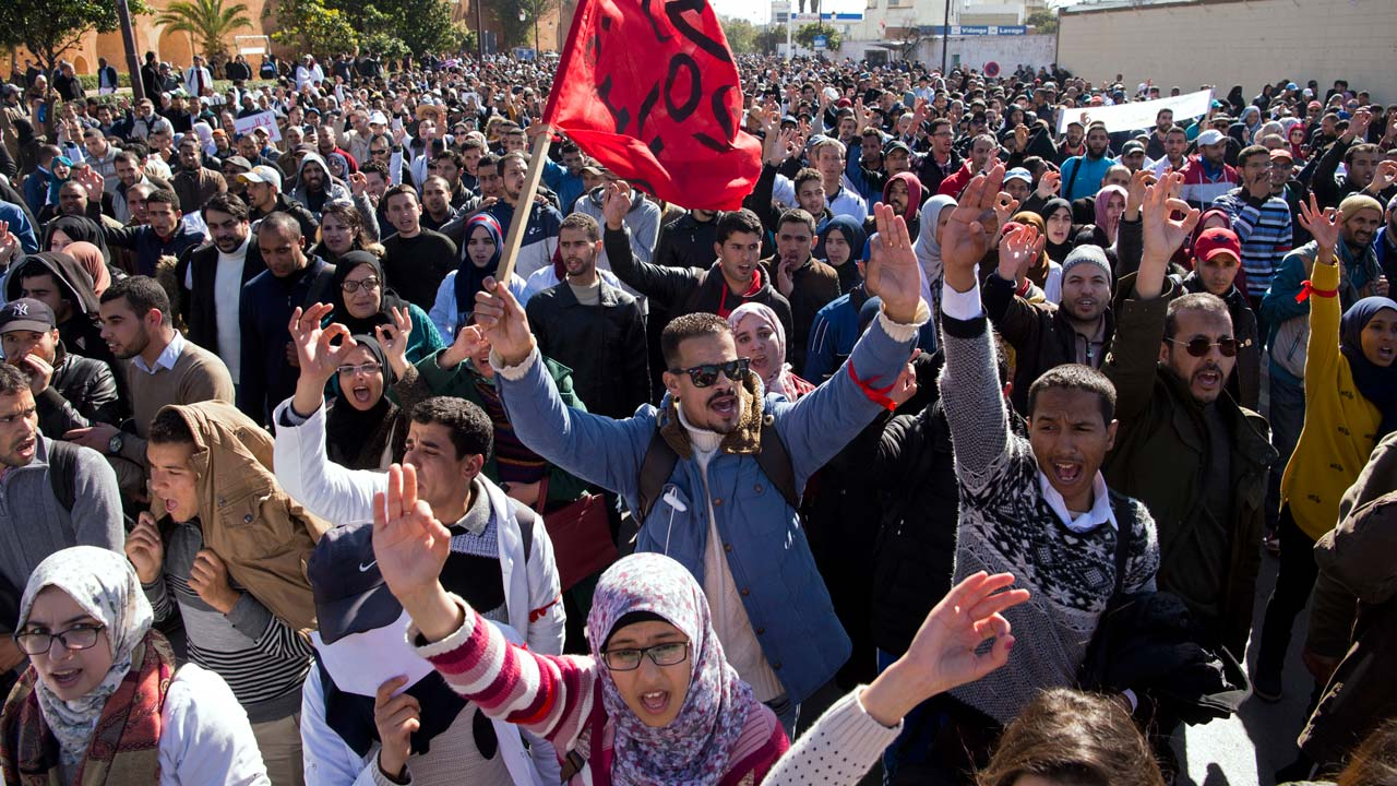 """Moroccan trainee teachers take part in a rally in Rabat on January 29, 2017, to protest against police violence and government-proposed decrees for the employment of trainees. Thousands of Moroccans took to the streets of Rabat in separate demonstrations, with workers protesting against """"corruption"""" and trainee teachers against government decisions affecting their job prospects. FADEL SENNA / AFP"""