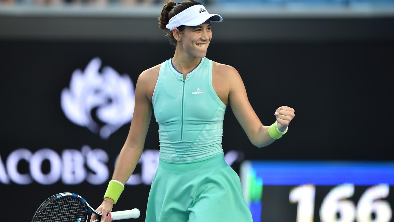 Spain's Garbine Muguruza celebrates her victory against Romania's Sorana Cirstea during their women's singles fourth round match on day seven of the Australian Open tennis tournament in Melbourne on January 22, 2017. PETER PARKS / AFP