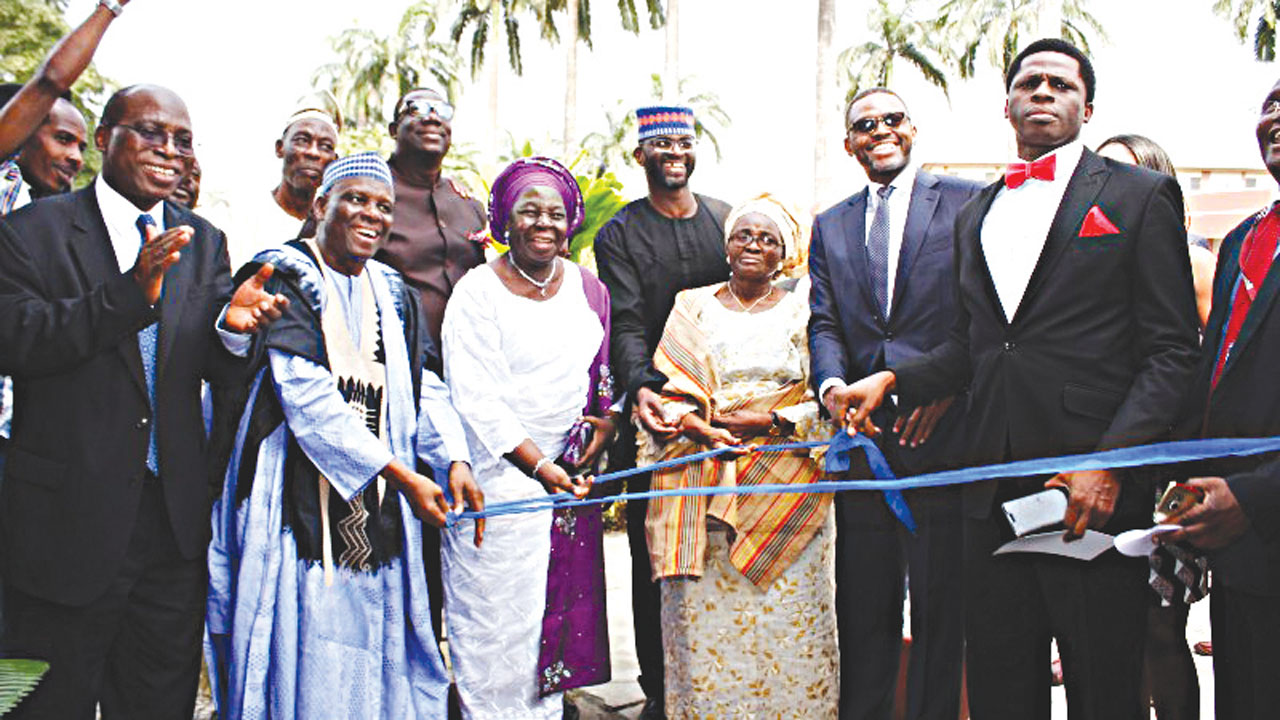Vice Chancellor, University of Lagos, Prof. Rahmon Ade Bello (left); Pro-Chancellor and Chairman Governing Council, Prof. Jerry Gana; wives of the former vice chancellors of the institution, late Prof. Jelili Adebisi Omotola, Shola and Adunola and the children, Goke and Adekunle at the unveiling of the multipurpose hall named after Omotola in Lagos... yesterday. PHOTO: FEMI ADEBESIN-KUTI