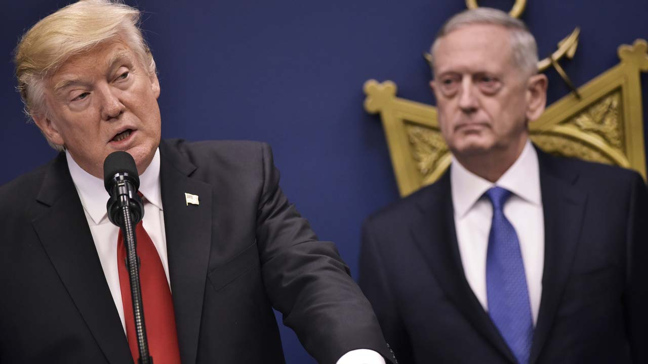 US President Donald Trump speaks following the ceremonial swearing-in of James Mattis (R) as secretary of defense on January 27, 2017, at the Pentagon in Washington, DC. MANDEL NGAN / AFP