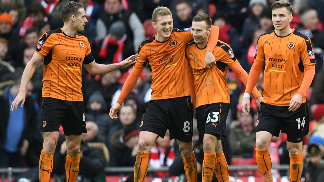 Wolverhampton Wanderers' Austrian striker Andreas Weimann (2R) celebrates scoring his team's second goal with Wolverhampton Wanderers' English midfielder George Saville (2L) during the English FA Cup fourth round football match between Liverpool and Wolverhampton Wanderers at Anfield in Liverpool, north west England on January 28, 2017. Paul ELLIS / AFP