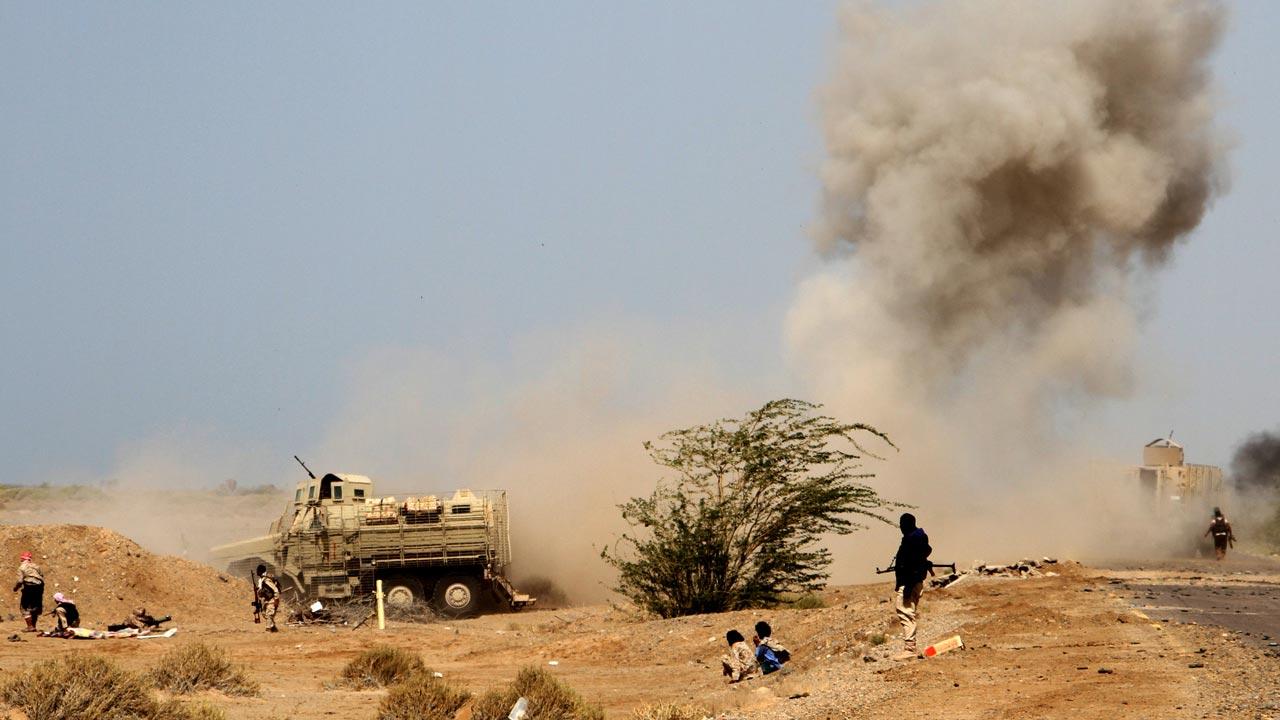 A landmine explodes as Yemeni loyalist forces patrol an area near the Red Sea port town of Mocha on January 20, 2017. SALEH AL-OBEIDI / AFP