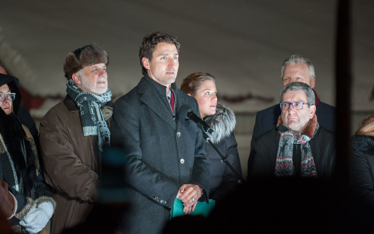 "Canadian prime minister Justin Trudeau (C) speaks during a rally near the Islamic Cultural Center in Quebec City, Canada on January 30, 2017. Gunmen stormed into a Quebec mosque during evening prayers January 29 and opened fire on dozens of worshippers, killing six and wounding eight in what Canadian Prime Minister Justin Trudeau condemned as a ""terrorist attack."" Canadian police sought Monday to piece together the motive for a shooting attack, one of the worst attacks ever to target Muslims in a western country. / AFP PHOTO / Alice Chiche"