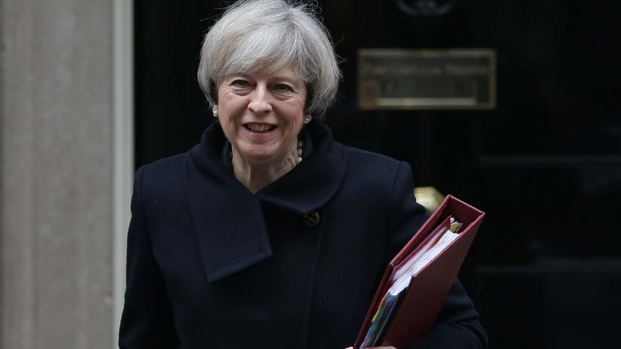 British Prime Minister Theresa May leaves 10 Downing street for the weekly Prime Minister's Questions session at the House of Commons in central London on February 1, 2017. British MPs are expected today to approve the first stage of a bill empowering Prime Minister Theresa May to start pulling Britain out of the European Union. Daniel LEAL-OLIVAS / AFP