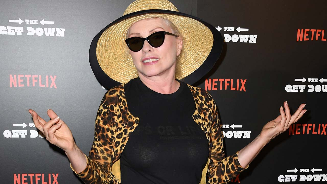 "(FILES) This file photo taken on August 11, 2016 shows singer Debbie Harry arrives for the premiere of ""The Get Down"" at Lehman Center for the Performing Arts in Bronx, New York. New Wave pioneers Blondie on February 1, 2017 announced a new album that will bring in stars from across generations including Sia and Joan Jett. Entitled ""Pollinator,"" the album will come out on May 5 and mark the first release in three years by the New York band fronted by 71-year-old Debbie Harry. The band released the album's first track, ""Fun,"" which harks back to the disco era but with more contemporary electronic beats. ANGELA WEISS / AFP"