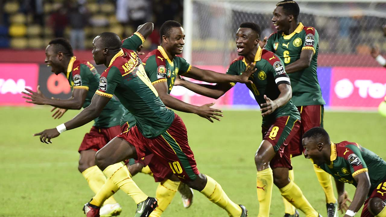 Cameroon's players celebrate after winning the penalty shootout at the end of the 2017 Africa Cup of Nations quarter-final football match between Senegal and Cameroon in Franceville on January 28, 2017. KHALED DESOUKI / AFP