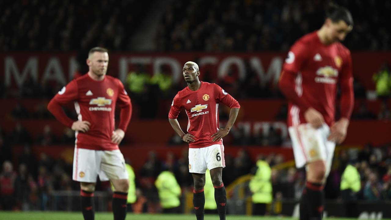 Manchester United's English striker Wayne Rooney (L) Manchester United's French midfielder Paul Pogba and Manchester United's Swedish striker Zlatan Ibrahimovic react following the English Premier League football match between Manchester United and Hull City at Old Trafford in Manchester, north west England, on February 1, 2017. The match ended in a draw at 0-0. Oli SCARFF / AFP