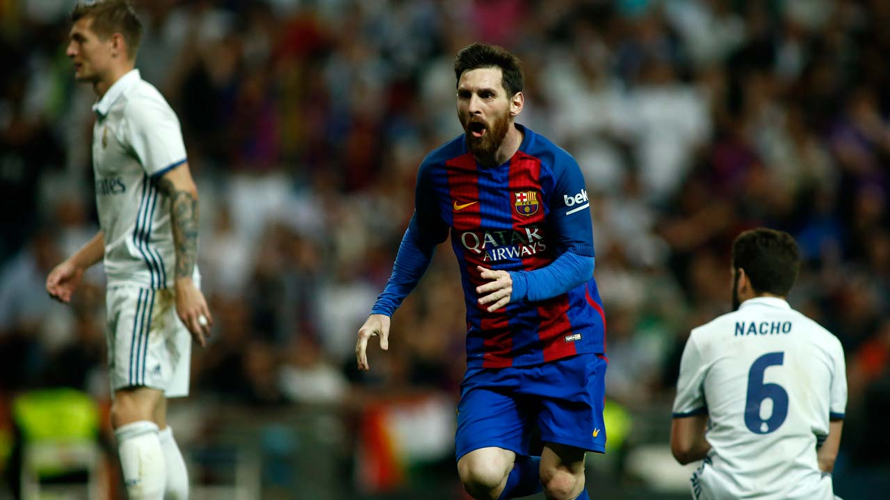 Barcelona s Argentinian forward Lionel Messi (C) celebrates after scoring  during the Spanish league Clasico football match Real Madrid CF vs FC  Barcelona at ... 48dd4861ba768