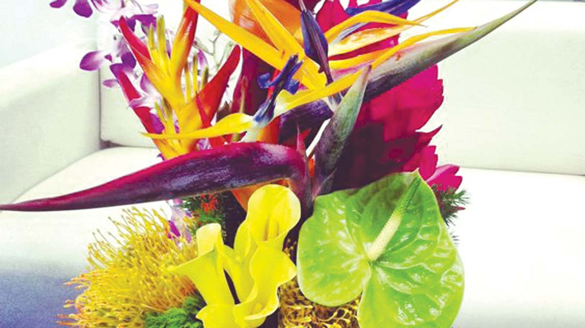 Flowers of easter saturday magazine the guardian nigeria tropical easter centerpiece floral arrangements with bird of paradise heleconias proteas orchids and calla lilies buycottarizona