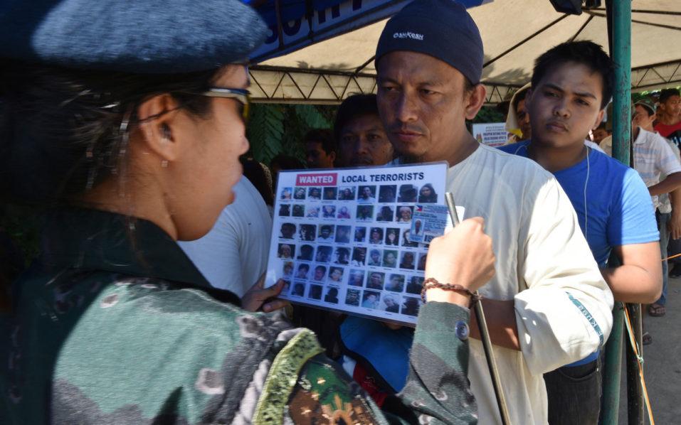 Philippines says militants shot dead at least 16 civilians