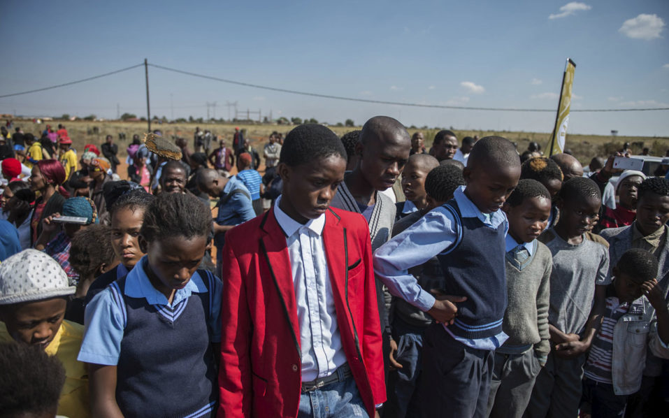 South Africa clashes after men accused of killing boy bailed