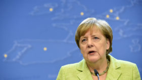 Merkel urges tougher rules to end sky-high transfers