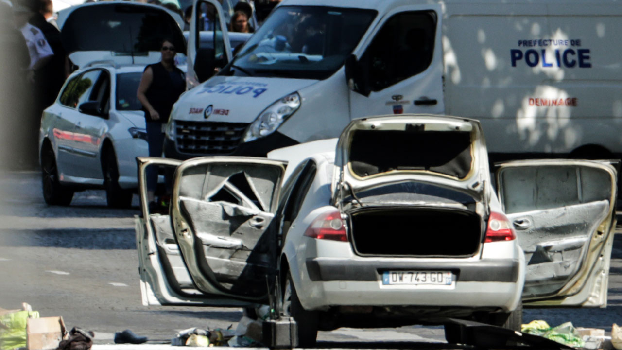 Car ploughs into police van in Paris Champs-Elysees 'attack'