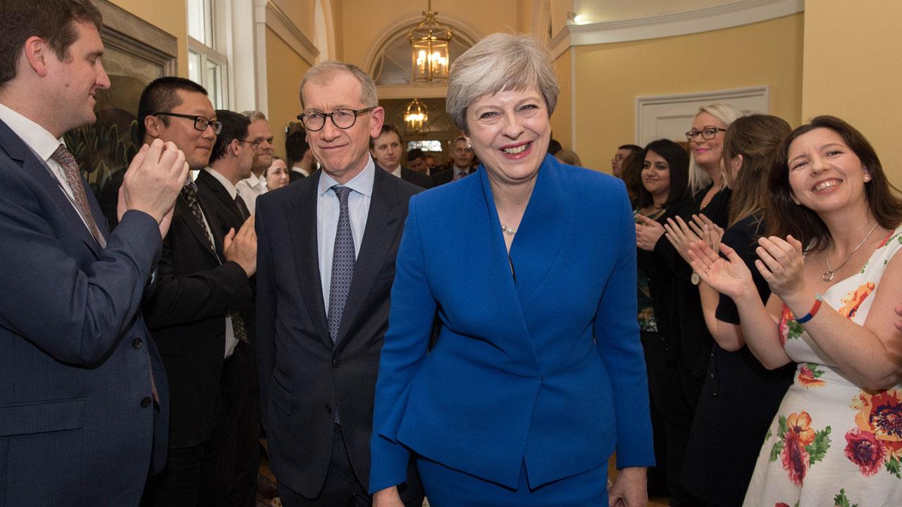 British PM under fresh pressure as top aides quit