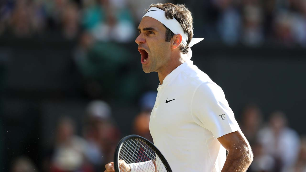 Federer into 12th Wimbledon semi-final