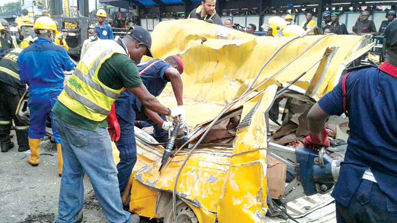 Dozen die as container falls on 2 commercial buses in Lagos