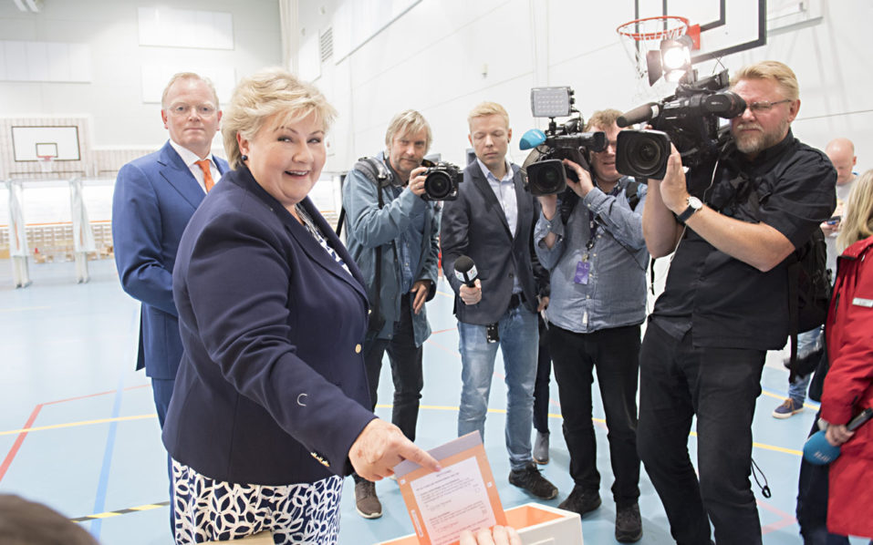 Norway's Prime Minister Erna Solberg retains power