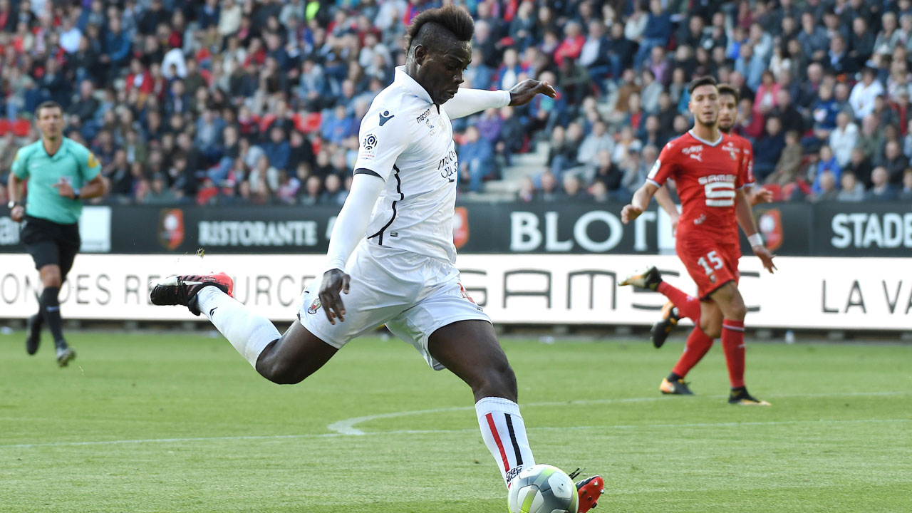 Nices Italian Forward Mario Balotelli Kicks To Score During The French L Football Match Between Rennes And Nice On September   At Roazhon Park In