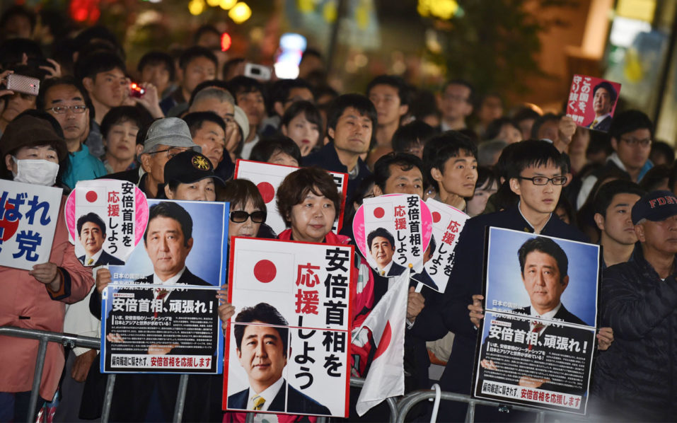 Exit polls show win for Japanese PM Abe's ruling coalition