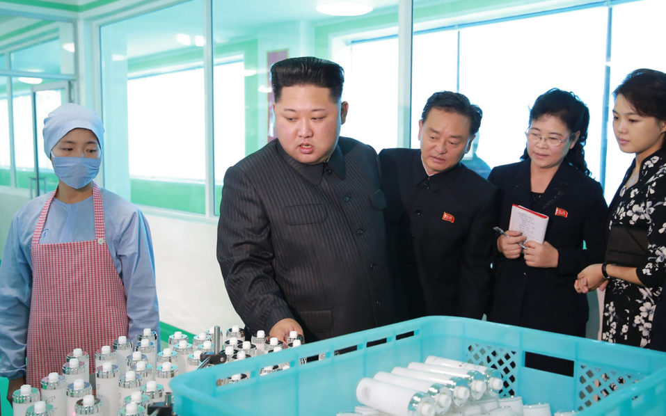north korea s kim tours cosmetics plant with wife sister world