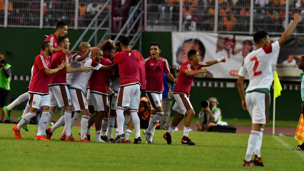 412f8f4a634 Morocco s team players celebrate at the Felix Houphouet-Boigny stadium in  Abidjan on November 11