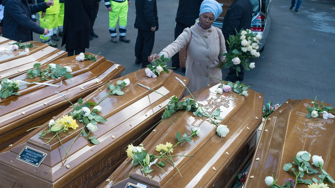 Nwanwenne trafficking illegal migration thrives on ignorance a woman lays flowers on the coffins of 26 teenage migrant girls found dead in the mediterranean in early november during the inter religious funeral izmirmasajfo Gallery