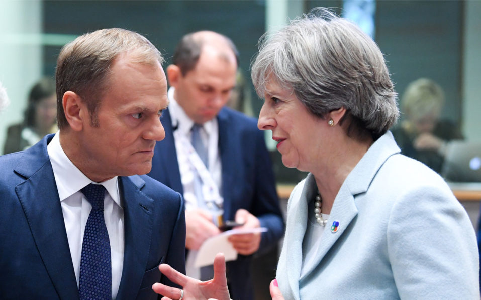 May urges EU to 'step forward' with UK for Brexit deal