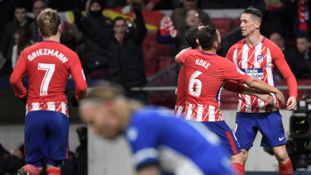 Torres lifts Atletico to second as Valencia falter
