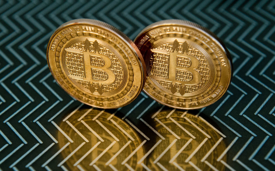 Central banker takes stab at bitcoin bubble business the files this june 17 2014 file photo taken in washington dc shows bitcoin medals bitcoin surged above 11000 for the first time on november 29 ccuart Choice Image