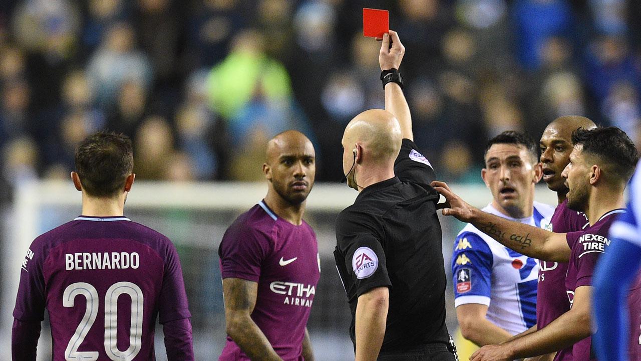 SPORT: Wigan end Man City quadruple bid with Cup shock