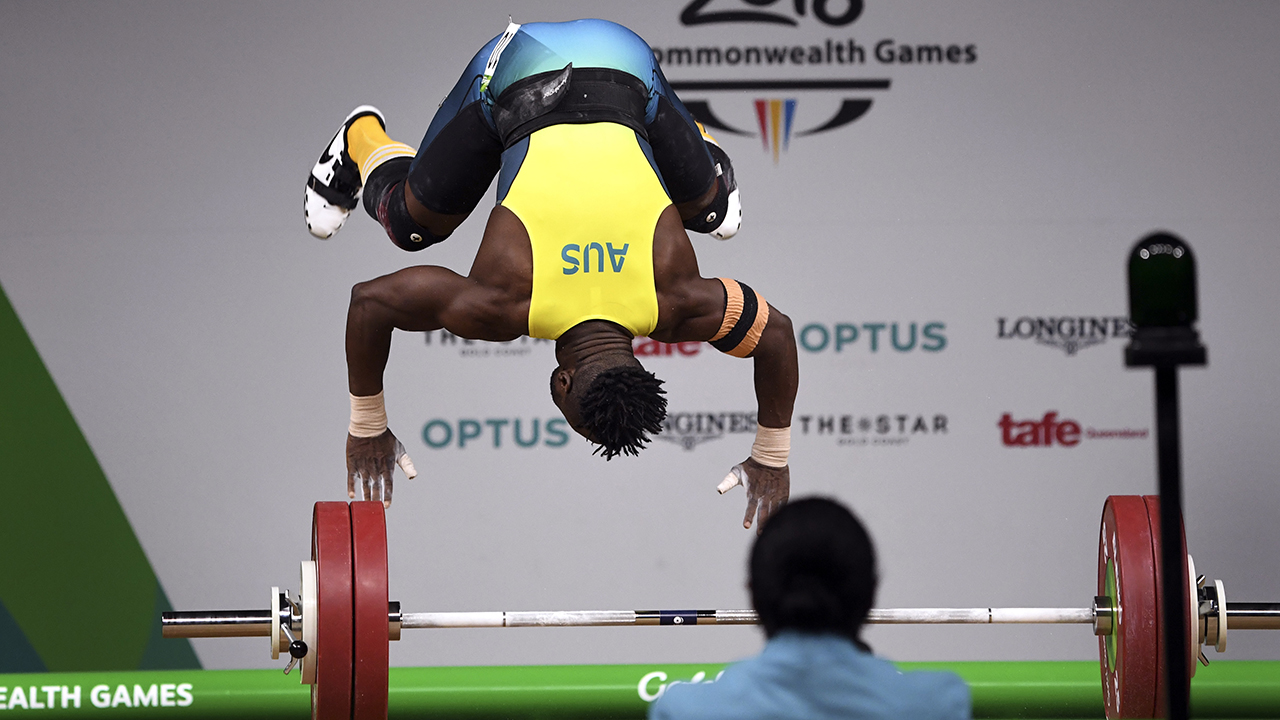 Commonwealth Games: 'Big Bear' David Liti treads lightly to weightlifting gold