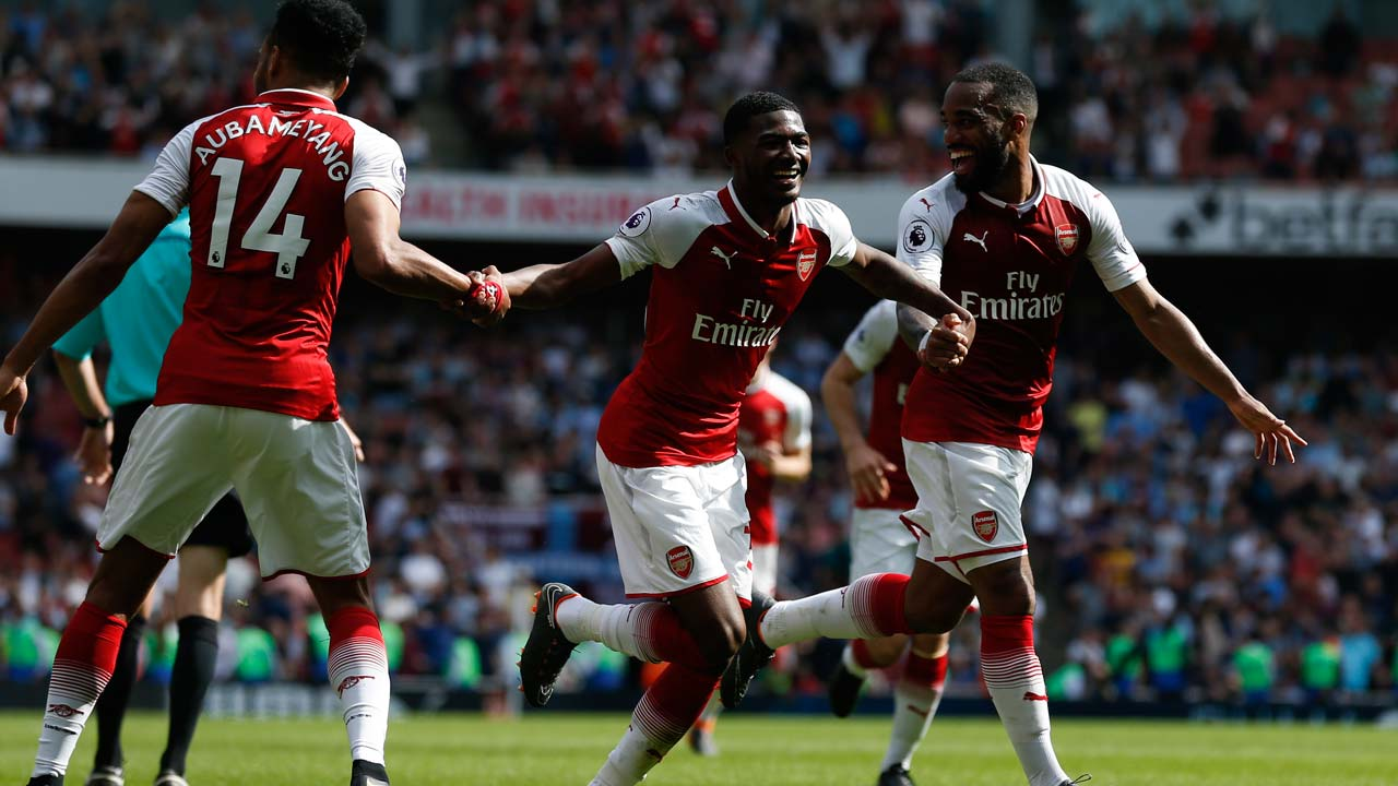 SPORT: Arsenal give Wenger reason to smile with West Ham hammering