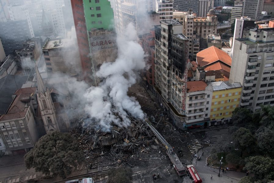 Fire-ravaged tower collapses in Brazil, people trapped inside