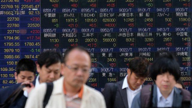 Tokyo's Nikkei closes up on weak yen